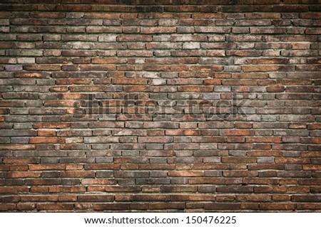 Old orange bricks wall background - stock photo