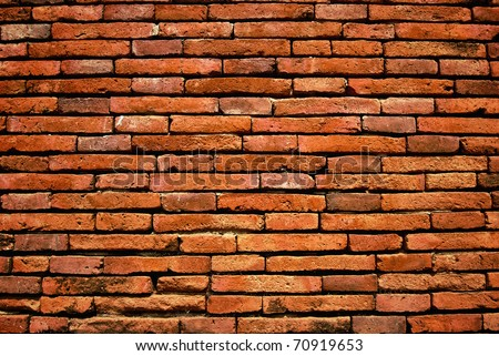 old orange cracked brick wall background texture - stock photo