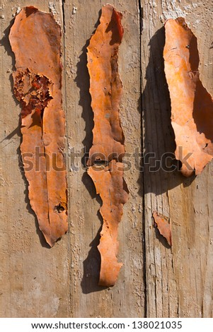 old orange paint on a wooden background