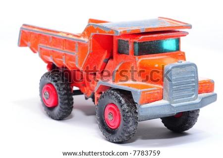 Old orange toy truck - stock photo