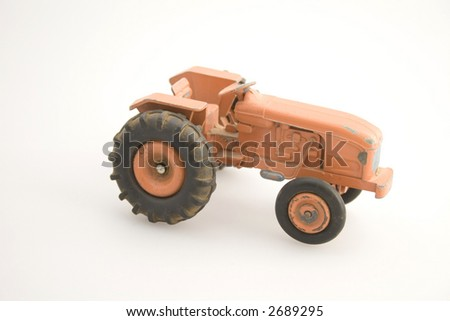 Old orange tractor - stock photo