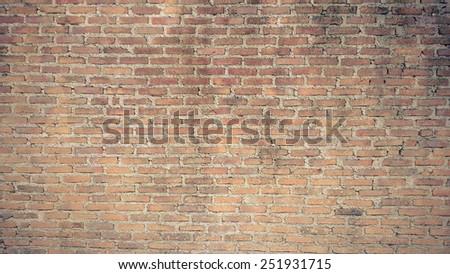 old orange vintage brick wall background - stock photo