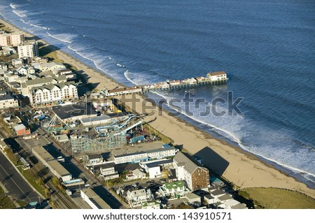 Old Orchard Beach downtown, pier, new hotel and amusement park on Maine Coastline south of Portland - stock photo