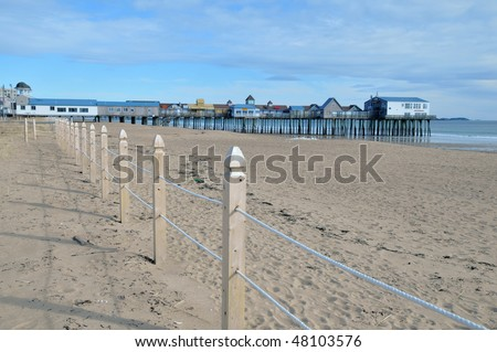 Old Orchard Beach, Maine, at low tide on a cold winter day - stock photo