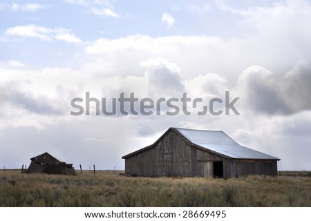Old Oregon barn in rural setting on blustery, stormy day. Near Kent, Oregon. - stock photo