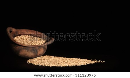 Old organic earth-ware cooking pot with wild organic rice
