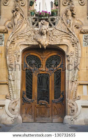 Old ornate wooden doors in Paris, France - stock photo