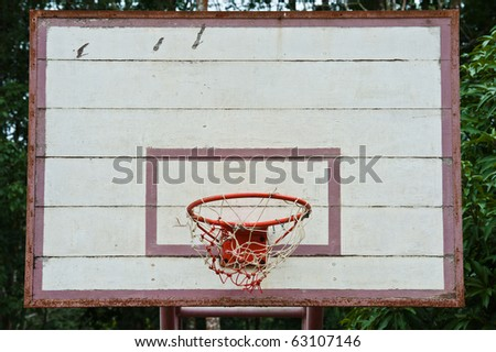old outdoor basketball hoop - stock photo