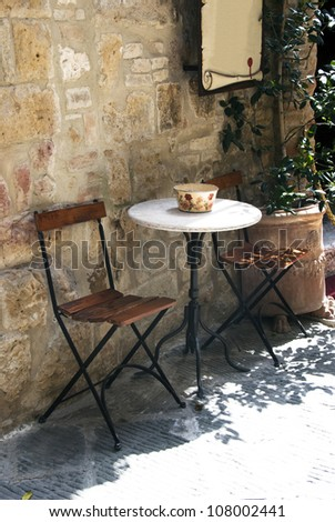 Old outdoor cafe in a traditional tuscany street - Italy - stock photo