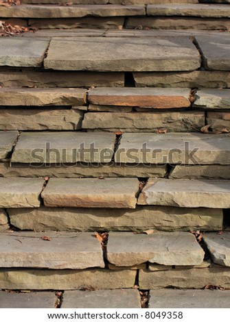 Old outdoor stone slate steps. - stock photo