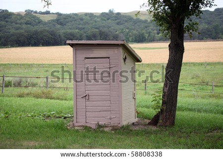 old outhouse - stock photo