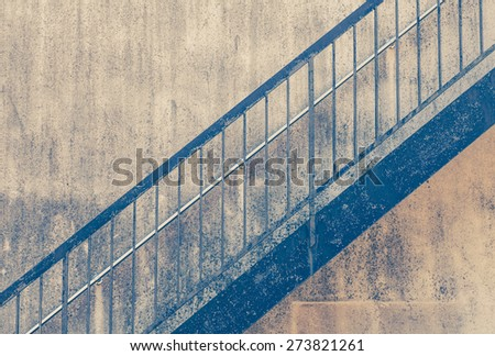 Old outside stair metal at old building  - stock photo