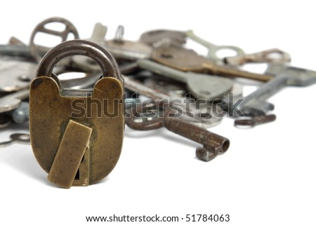Old padlock and heap of keys isolated on white - stock photo