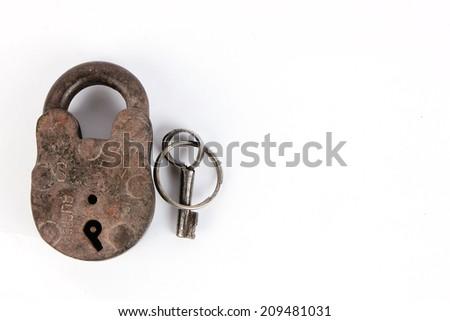 Old padlock and key. - stock photo