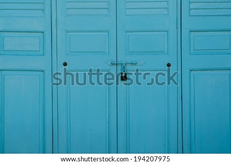 old padlock on blue wooden door in temple
