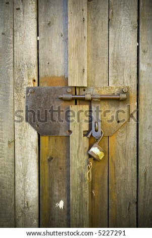 Old padlock on wood doors