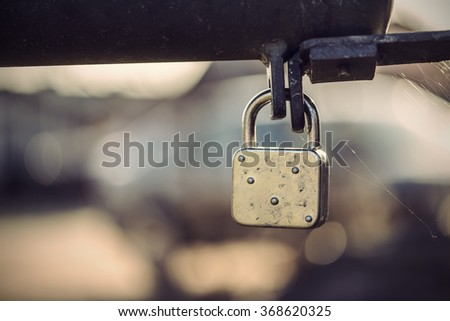 old padlock outdoor, vintage filtered style - stock photo