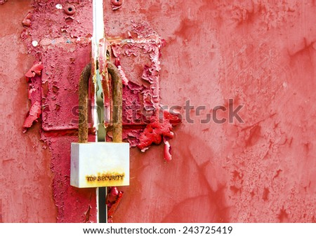 Old padlock with red gate - stock photo