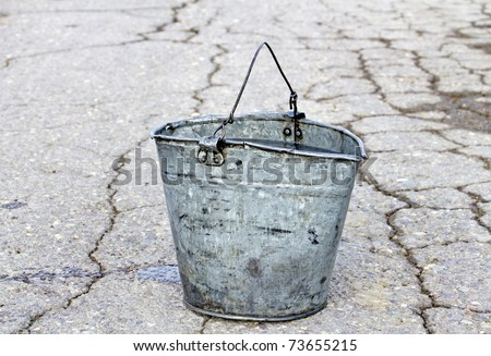 old pail water on road stock photo royalty free 73655215