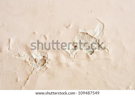 old paint and wall, cracked wall color pink - stock photo