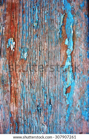 old paint on a wooden surface - stock photo