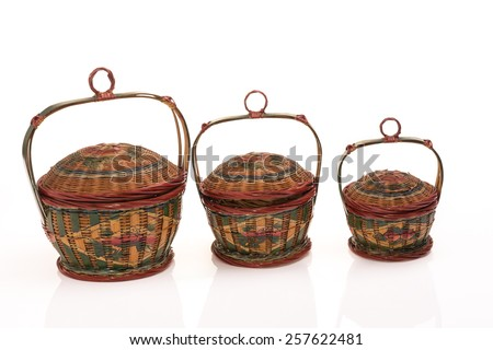 Old paint rattan basket from China on White Isolated background - stock photo