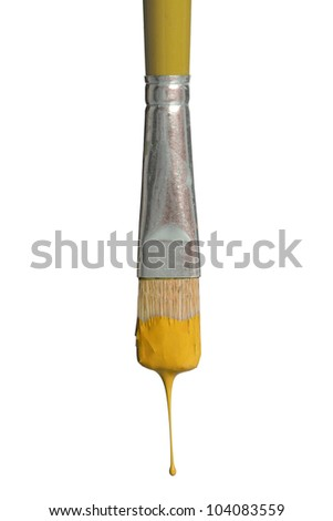Old paintbrush dripping yellow paint isolated over white background - stock photo