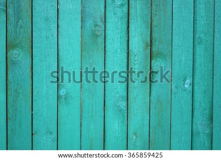 Old painted aquamarine blue fence. Wooden boards texture or background.                                - stock photo