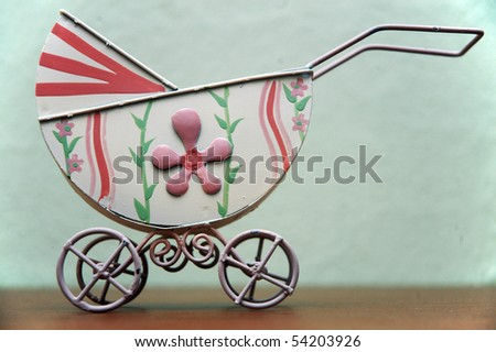 old painted buggy with flowers - stock photo