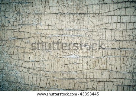Old painted cracked peeling wood texture, closeup - stock photo
