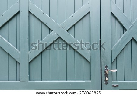 old painted decorated wooden board door with a metal handle - stock photo