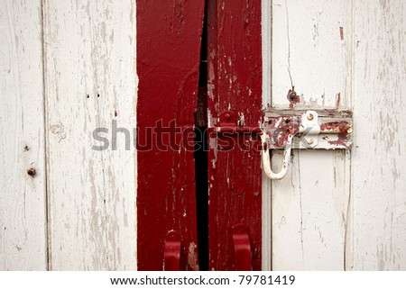 Old painted lock on the barn doors. - stock photo