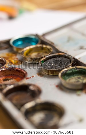 Old paints artists paintbrushes paints and brushes background - stock photo