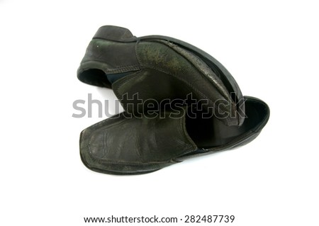 Old pair of black male shoes