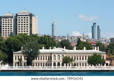 old palace on the Bosporus waterfront on the background the skyscrapers of modern Levent neighborhood in Istanbul, Turkey
