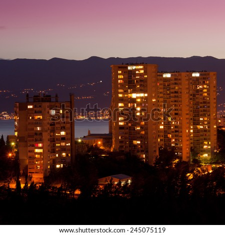 Old panel apartments in Rijeka at night - stock photo