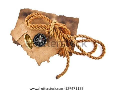 old paper and a compass on a white background - stock photo