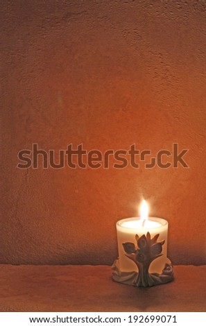 Old paper and candle flame perfect background for copy space.   - stock photo