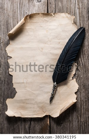 old paper and fountain pen on the wooden board - stock photo