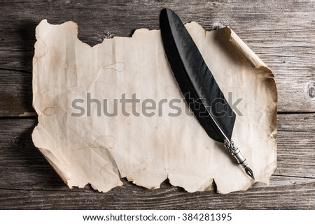 old paper and fountain pen on the wooden board