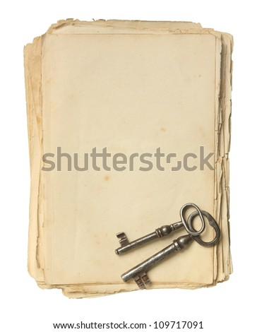 Old paper and keys isolated on a white background.