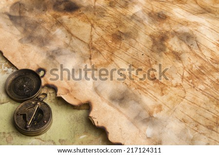 Old paper background and vintage compass - stock photo