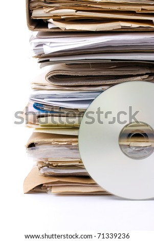 Old paper files and modern cd archive - stock photo