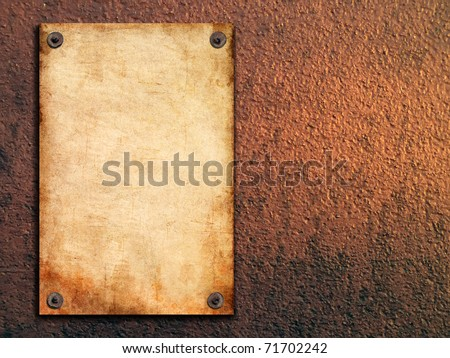 old paper is attached with nails on painted walls - stock photo