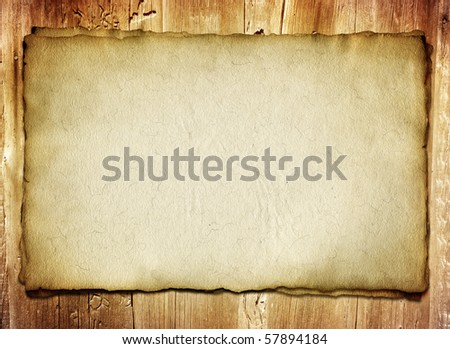 old paper map on wooden background - stock photo