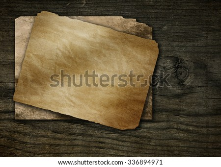 old paper on a wooden background grunge