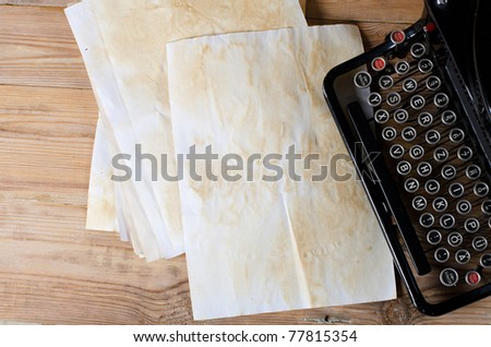 Old paper on a wooden surface - stock photo