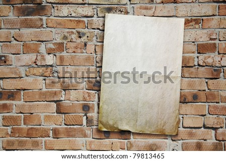 old paper on brickwall - stock photo