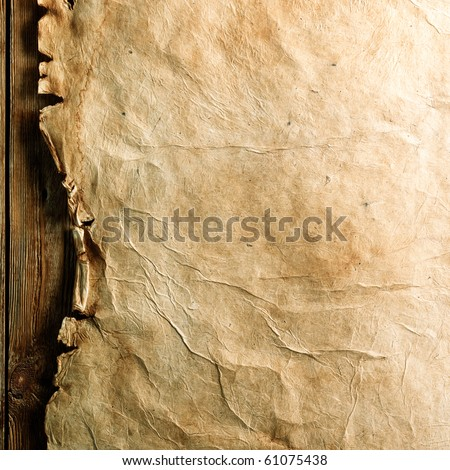 Old paper on brown wood board - stock photo