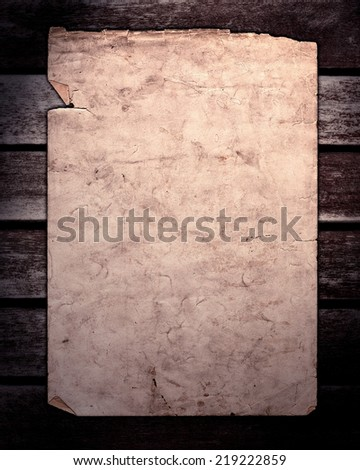 Old paper on brown wood texture, horizontal slats from a weathered bench with lighting - stock photo
